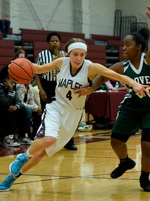 Caroline Owens (4) finished with 16 points in Monday's exciting comeback victory over Groves in a first-round Class A district playoff game.