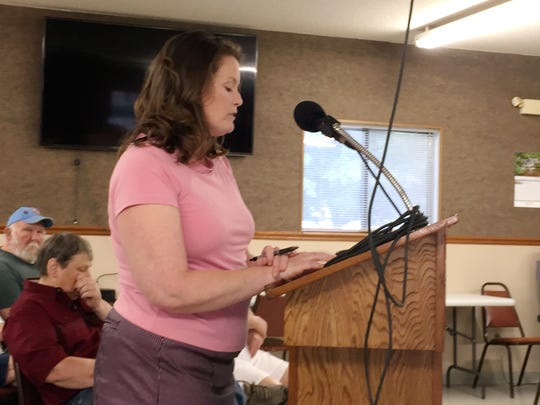 Chrysta Fouser addresses the Bull Shoals City Council about the reinstatement of firefighter Brian Williams.