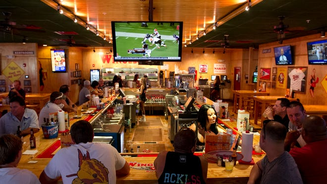 Ker's WingHouse Bar & Grill in Fort Myers features flat screens for sports, plenty of tables and a loaded menu.