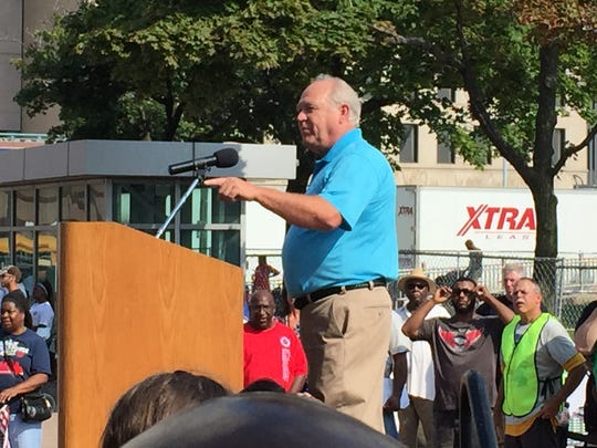 UAW President Dennis Williams speaks to union members and supporters at Laborfest in Detroit at the Ford National Programs Center on Monday, Sept. 7, 2015.