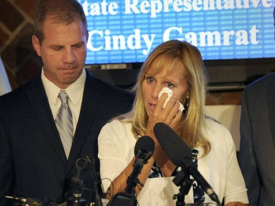 Joe Gamrat appears with his wife, former state Rep. Cindy Gamrat, at a press conference in East Lansing.