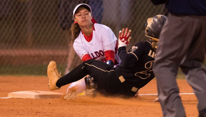 South Fork's Malea Rolle, at third base, catches the throw from left-fielder Olivia Turull to tag Olympic Heights's Gillian Lapis out on an attempted sacrifice fly ball to end the top of the fifth inning during the Region 4-7A quarterfinal high school softball game Wednesday, May 2, 2018, at South Fork High School in Tropical Farms.