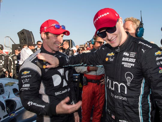 IndyCar Series driver Simon Pagenaud (left) celebrates with driver Josef Newgarden (right) after the GoPro Grand Prix of Sonoma at Sonoma Raceway.