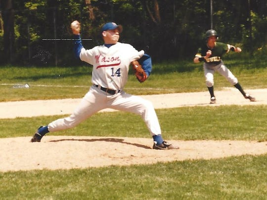 Brian Holcomb pitches against Howell during his senior year for the Mason High Bulldogs in 1998.