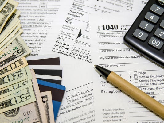tax form, credit cards, the calculator, pen and money