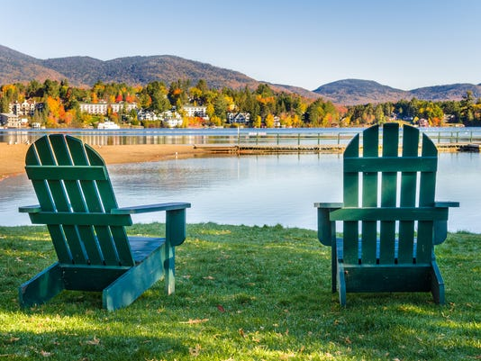 Adirondack Chairs on the Shore of Lake on a Clear Fall Morning