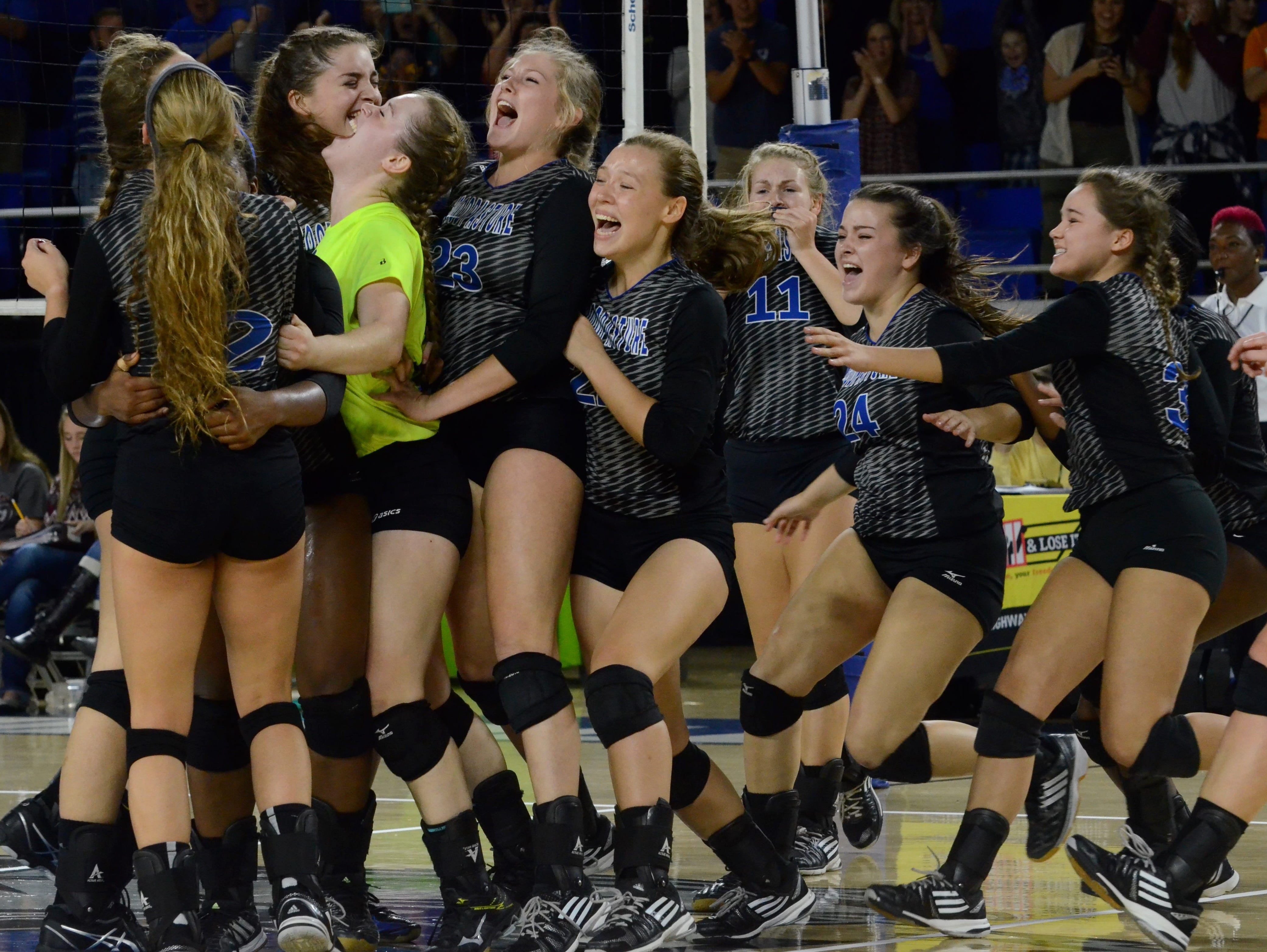 Goodpasture celebrates after beating South Greene for the Class A state volleyball championship.