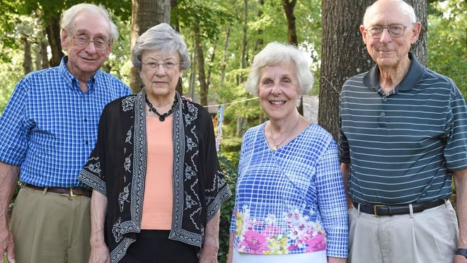 Mitch and Nancy Llewelyn, left, and Mary and Dr. Taylor Prewitt were honored by many friends with a drive-by caravan of well-wishers on Aug. 16.