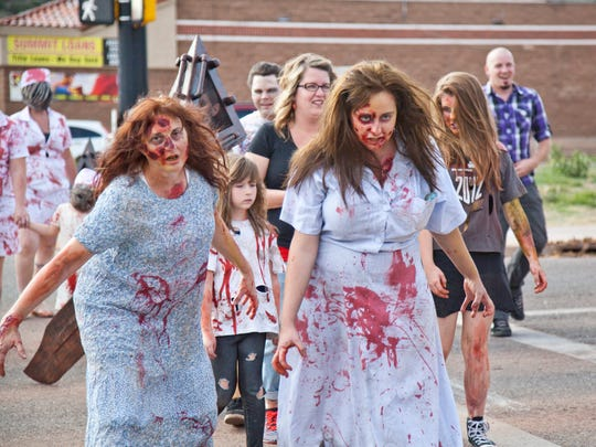 St. George residents gather for the fifth annual Zombie Walk at Comics Plus and the St. George Blvd. to raise food for Dixie Care & Share Saturday, Oct. 18, 2014.