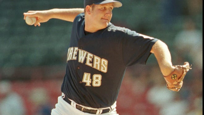 Milwaukee Brewers starter Steve Woodard delivers a pitch in the first inning July 28, 1997, in Milwaukee in his Major League debut, a memorable 1-0 win over Toronto.