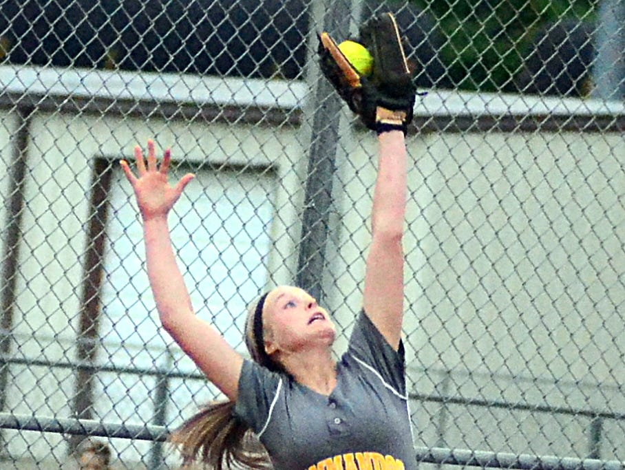 Hendersonville High junior third baseman M.J. Mattei makes a leaping catch of a high throw during second-inning action.