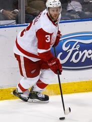 Detroit Red Wings defenseman Nick Jensen (3) clears