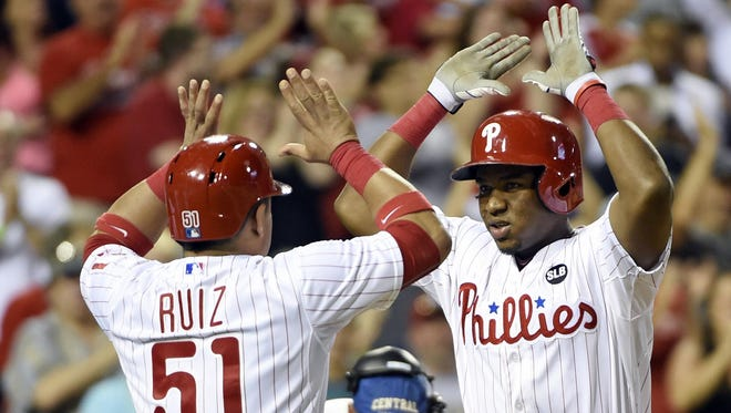Phillies third baseman Maikel Franco (right) celebrates hitting a grand slam home run during the seventh inning Tuesday with catcher Carlos Ruiz against the Los Angeles Dodgers at Citizens Bank Park in Philadelphia.