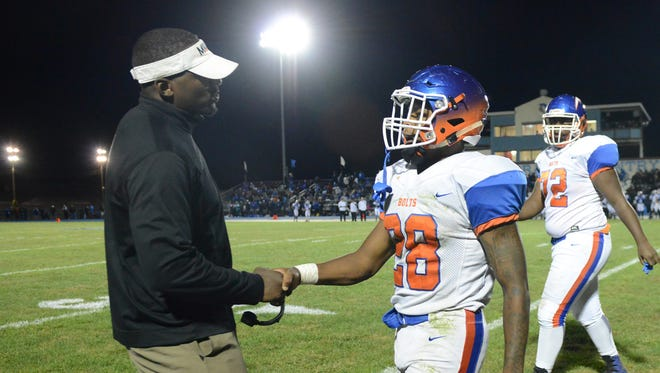 Millville head coach Dennis Thomas chats with Clayton Scott after a thunder bolts scoring drive in of the first half of Saturday night's football game against Williamstown. 09.30.17.