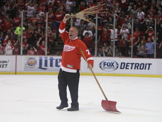 Red Wings zamboni driver Al Sobotka celebrates after