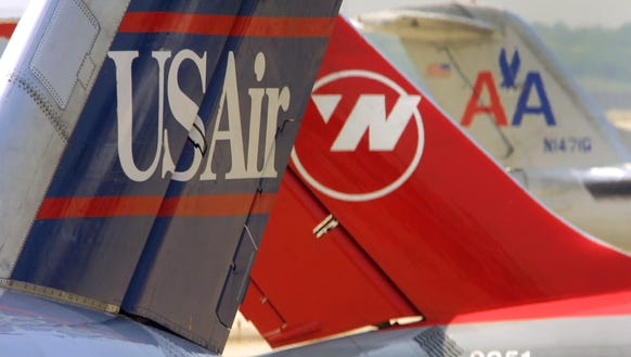 Tails of USAir, Northwest and American can bee seen