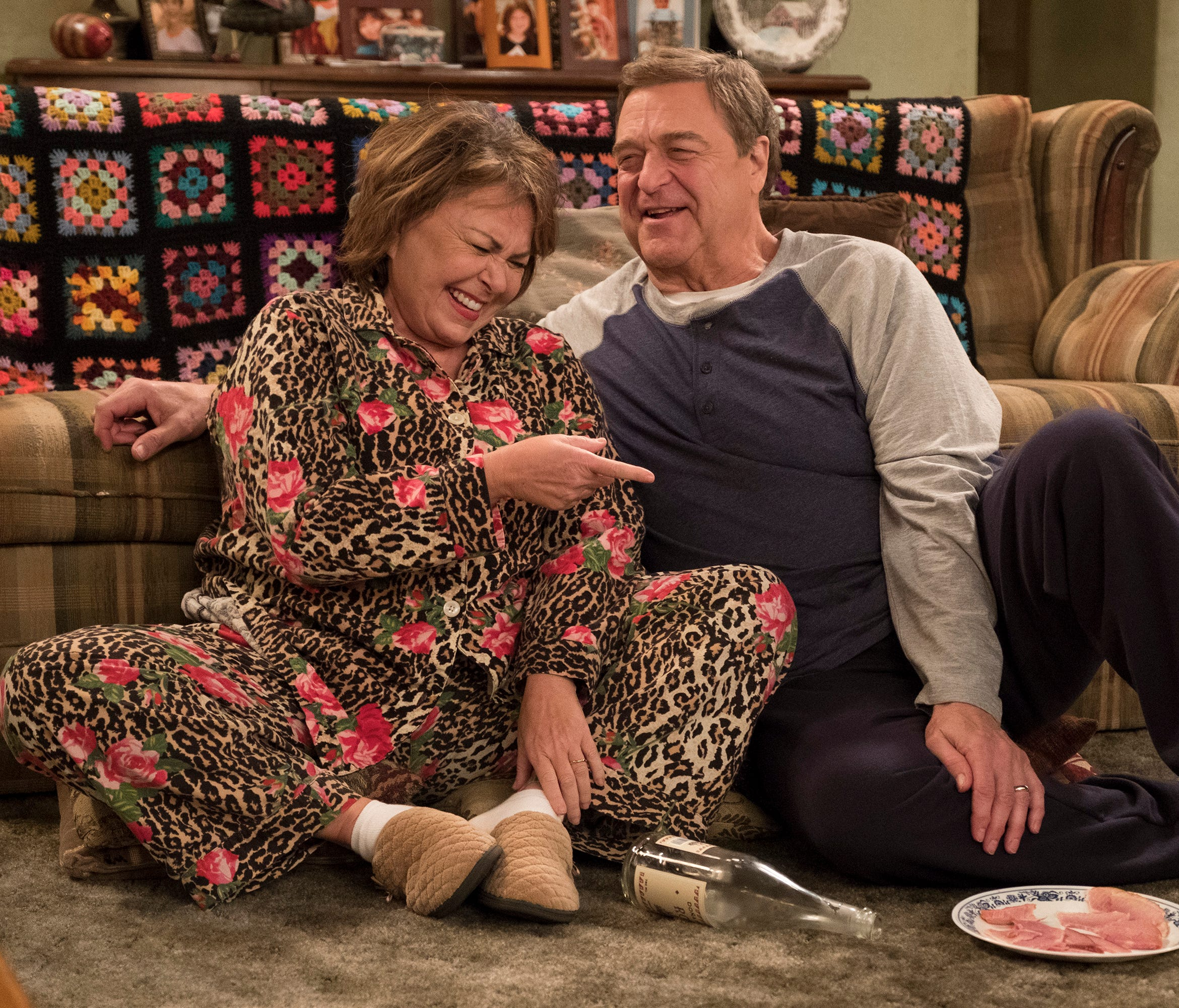 Roseanne Barr as Roseanne and John Goodman as Dan on