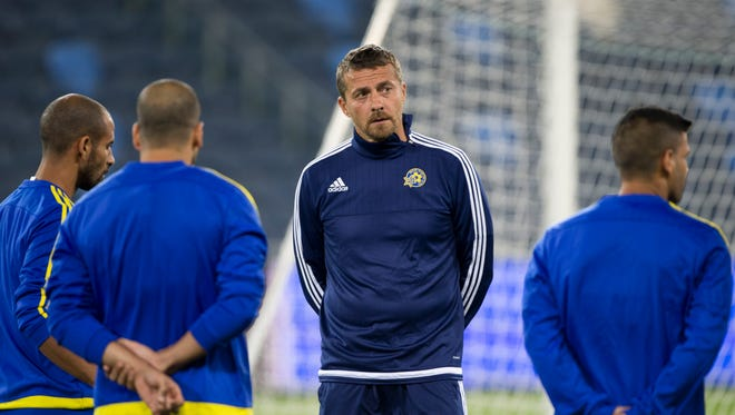 Slavisa Jokanovic stands on the pitch during training ahead of group G Champions League soccer match against FC Porto in Haifa, Israel,