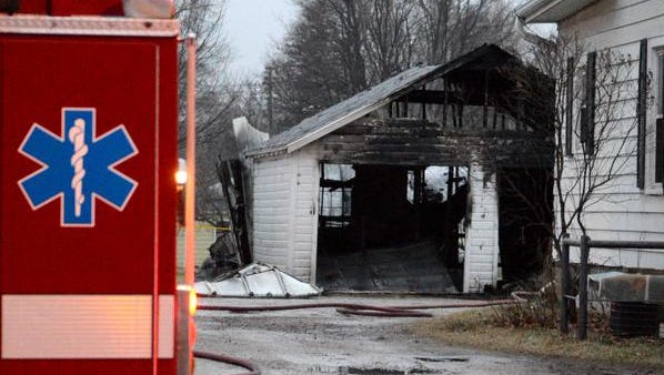 A vacant garage behind a home on East Mason Street on Green Bay's east side was destroyed by fire on Friday.