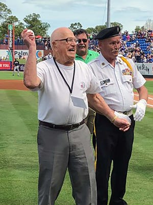 World War II veteran Mel Brown, who is 104 years old, tosses out the first  pitch before a recent New York Mets vs. New York Yankees Spring training game.