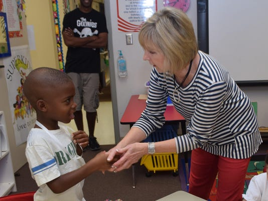 ANI Alex Country Day Riley Brown (left) greets his first grade teacher Ginger Cespiva at Alexandria Country Day School. Wednesday, Aug. 12, 2015 marked the first day of school for Alexandria Country Day School. -Melinda Martinez/The Town Talk