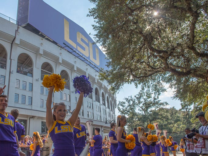 LSU cheerleaders cheer on the fans ahead of the Tigers'