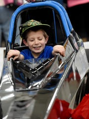 Eric Earhart, 7, is all smiles as he gets his photo taken in a junior dragster during the Racing Xtravaganza in the Utz Arena at the York Expo Center on Saturday, Feb. 4, 2016. In addition to a Kid Zone, the event, which runs on both Saturday and Sunday, offers meet and greets with drivers, seminars and over 120 cars to view.