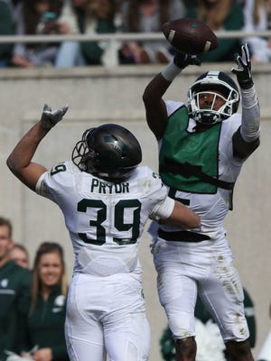 Michigan State receiver Justin Layne makes a catch against defensive back Corey Pryor during the spring game at Spartan Stadium, Saturday, April 1, 2017.