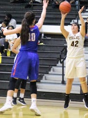 Alamogordo's Darian Cosgray puts up a shot.