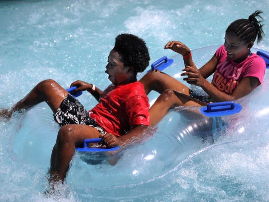 Paco Taylor (left), 10, and Lyrick Collins, 12, react