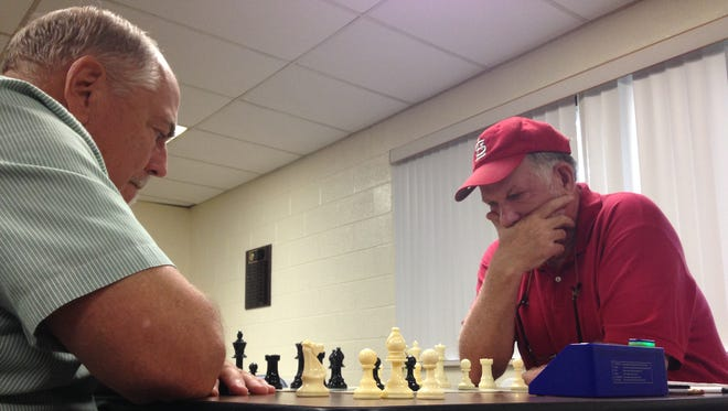 Lon Rutkofske and Stew Wilkinson play chess at the Palmer Park Recreation Center in Port Huron.