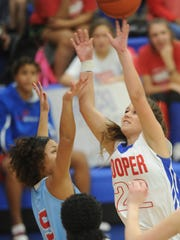 Cooper's Ellie McMillon 22) drives for a shot against