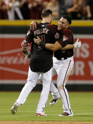 Arizona Diamondbacks' A.J. Pollock celebrates with David Peralta after hitting an RBI single in the ninth inning to defeat the Houston Astros 4-3 in a baseball game Saturday, May 5, 2018, in Phoenix.