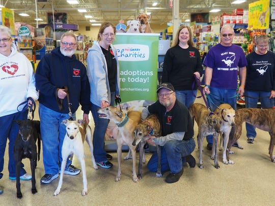 Members of Heart Bound Greyhound Adoption pose with