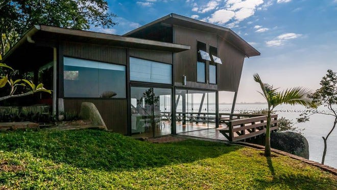 "Governador Celso Ramos, Santa Catarina, Brazil • 5 beds, 2.5 baths • ""Come for a weekend, a week, two weeks, a month or more… This property is natural and beautiful: you will not regret it."" Courtesy of Airbnb"