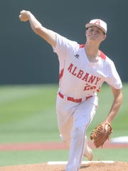 Albany starting pitcher Ryan Hill throws a pitch Stinnett