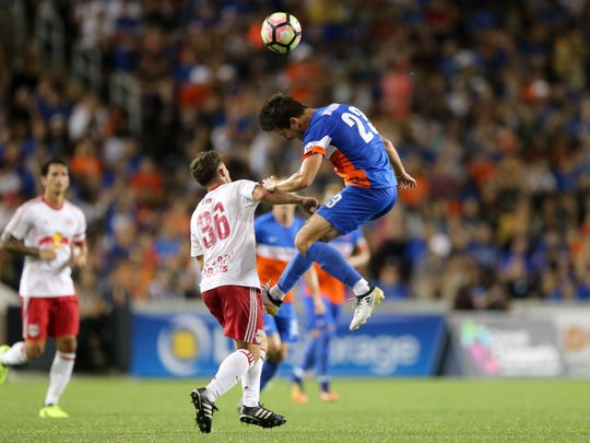 FC Cincinnati forward Andrew Wiedeman (23) goes up for a challenge in the second half during the USL soccer match between the New York Red Bulls II and FC Cincinnati, Saturday, Sept. 16, 2017, at Nippert Stadium in Cincinnati. FC Cincinnati won 4-2.