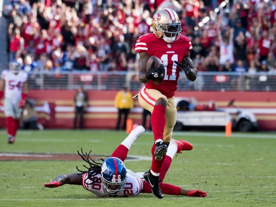 Santa Clara, CA, USA; San Francisco 49ers wide receiver Marquise Goodwin (11) runs past New York Giants cornerback Janoris Jenkins (20) for a touchdown during the second quarter at Levi's Stadium on Nov. 12.