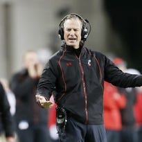 Bearcats head coach Tommy Tuberville argues with an official in the first quarter during the Nov. 14 game against Tulsa.