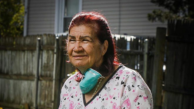 Virginia Carrasco, 71, housekeeper at Summit Commons nursing home in Providence.