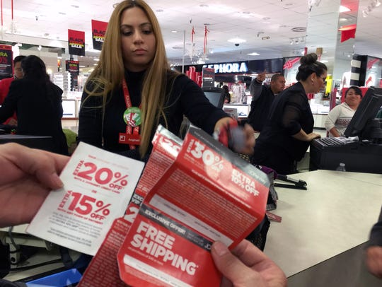 Shoppers use extra mail-in discount coupons at a J.C.