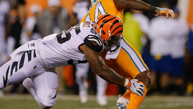 Cincinnati Bengals outside linebacker Vontaze Burfict (55) tackles Miami Dolphins wide receiver Jarvis Landry (14) in the fourth quarter during the NFL game between Miami Dolphins and the Cincinnati Bengals, Thursday, Sept. 29, 2016, at Paul Brown Stadium in Cincinnati.