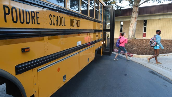 Sixth graders get off a school bus at Blen=vins Middle School, during the first day of school at Monday Aug. 18, 2014.