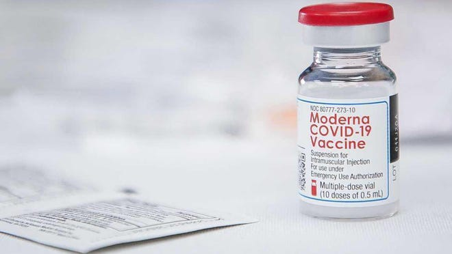 Staff at United Memorial Medical Center administer doses of Moderna's COVID-19 vaccine after receiving a delivery of 200 doses, Monday, Dec. 21, 2020, in Houston.