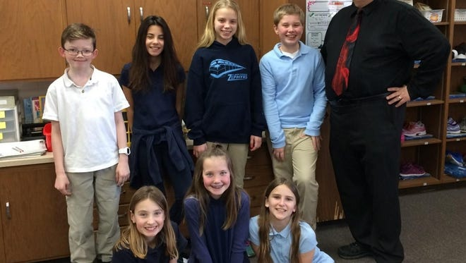 Fifth-grade band students at St. Gabriel Elementary School are excited to join with the fourth-grade band students as mentors. Teacher Dave Sawall is helping the group prepare for the spring concert. Pictured are, first row, from left, Grace Ogden, Geneva Miller, Jaylyn Akey; second row, Logan Balensiefen, Liana Irish, Emily Vogel, Greg Wheeler and Sawall.