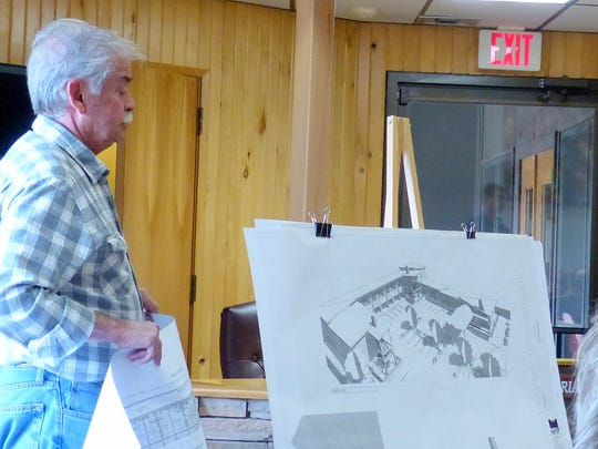 Contractor Louis Peralta shows the plans for the new motel to the audience at the Ruidoso Planning Commission meeting.