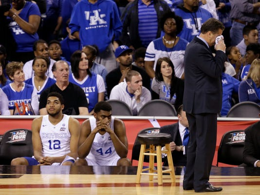 FILE - In this April 4, 2015, file photo, Kentucky head coach John Calipari wipes his face after the NCAA Final Four tournament college basketball semifinal game against Wisconsin in Indianapolis. The Wildcats were 38-0 heading into the 2015 men's basketball national semifinals against Wisconsin, a mere two wins away from being the first 40-0 team in college basketball history and on the brink of being the sport's first undefeated champion since Indiana in 1976. (AP Photo/Darron Cummings, File)