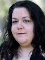 In this April 19, 2018 photo, Alyssa Pladl poses at a park in Richmond, Va. Alyssa Pladl, the ex-wife of Steven Pladl, who police say killed three people and himself after an incestuous marriage to his biological daughter says he had an explosive temper and a history of abusive behavior. (AP Photo/Steve Helber)
