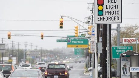 File: Motorists await end of red light experiment in New Jersey.