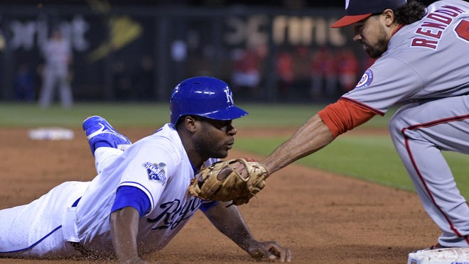 Kansas City Royals center fielder Lorenzo Cain is caught trying to steal third base by Washington Nationals third baseman Anthony Rendon in the third inning at Kauffman Stadium Monday in Kansas City.